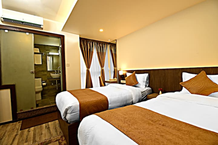 Deluxe Twin Room at The Milestone Hotel