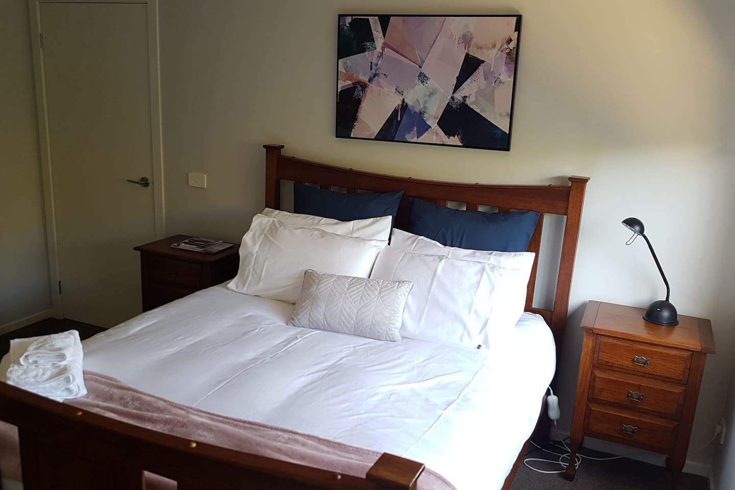 A comfortable quiet bedroom, new queen size mattress, and a wardrobe for guests to use.