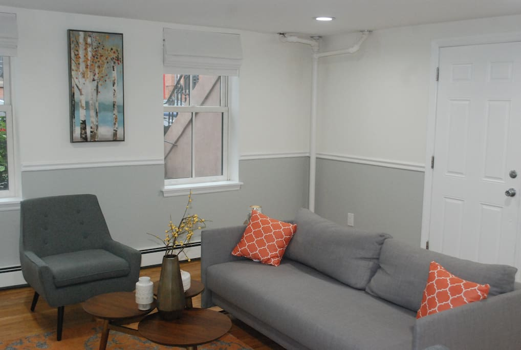 Comfy living room with loads of entertainment options and a sleek sleeper sofa