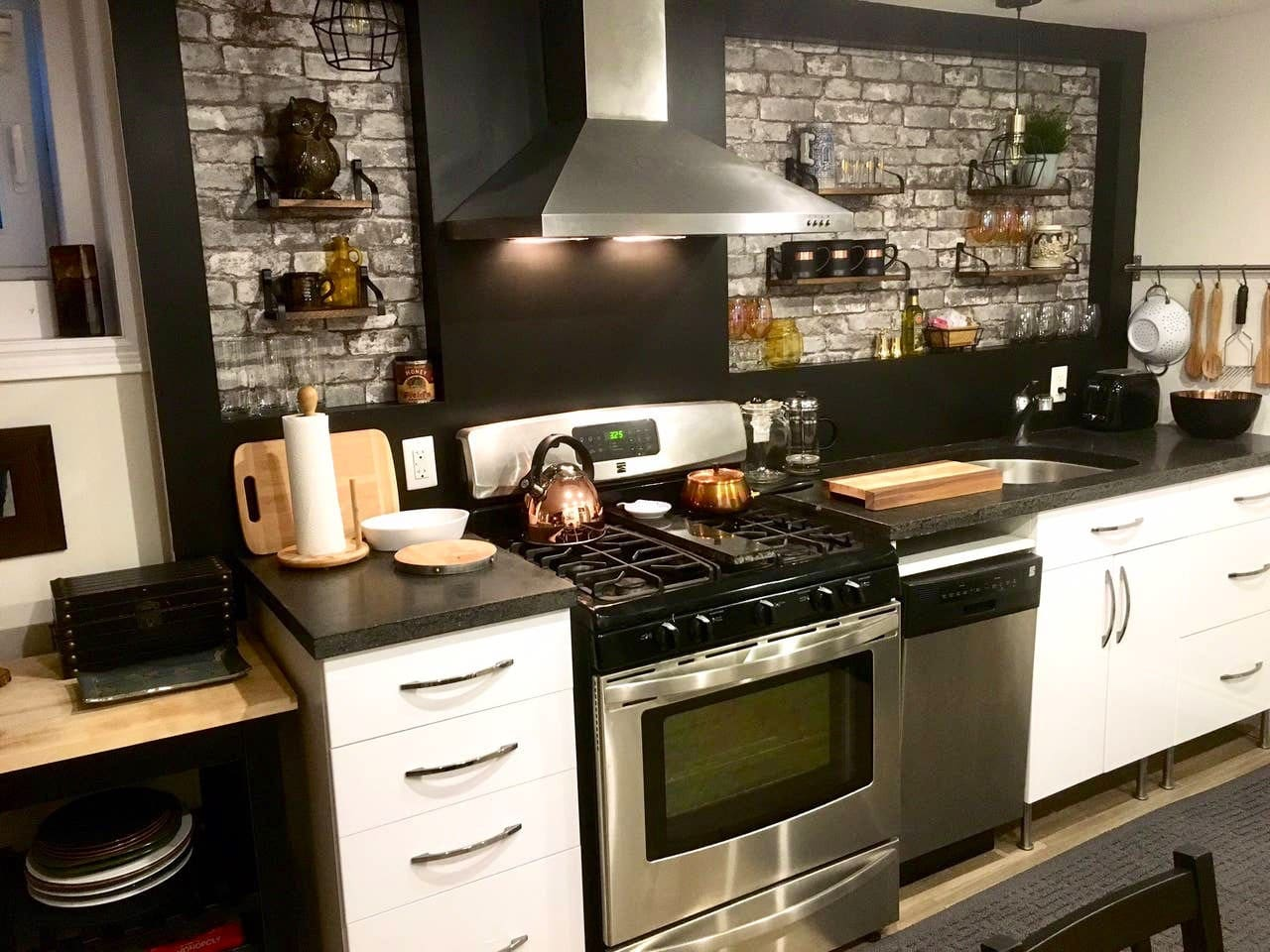 Full beautiful kitchen, recently re-done and designed by a professional interior decorator. Gorgeous gas stove, and fully stocked with everything you could need.