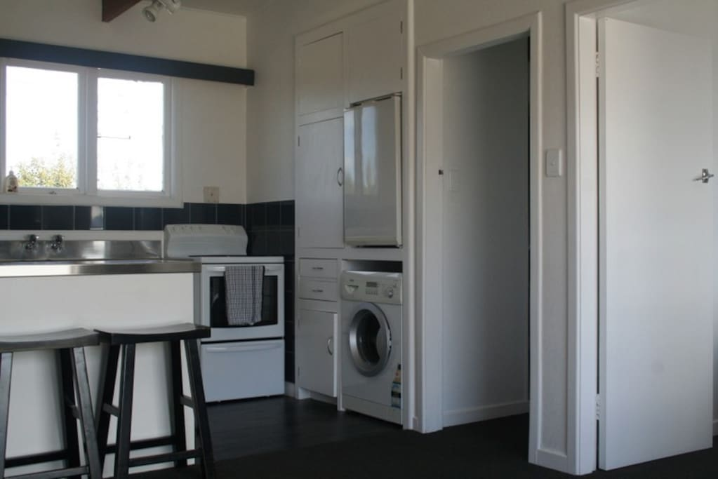 Kitchen has fridge/ mirowave/oven/stove and washing machine, laundry washing powered provided.