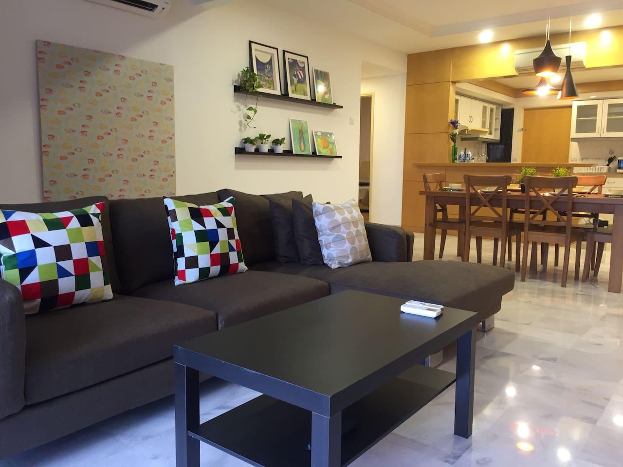 "Sofa with 50"" TV and KL city skyline view.e"