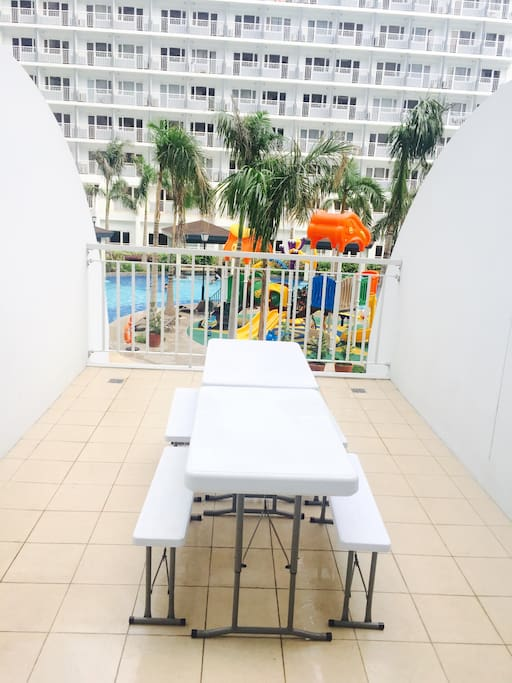 Huge Balcony with a very good view of Amenities (pool and playground). Good place to chill and hang out with family and friends.