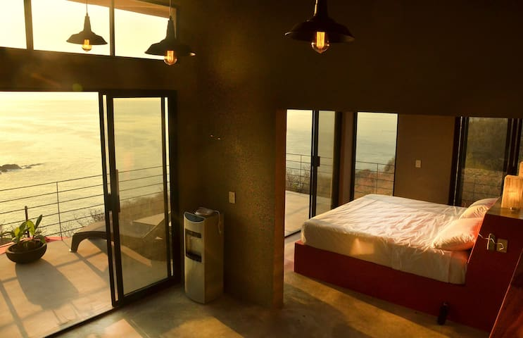 King size bed in penthouse with a view
