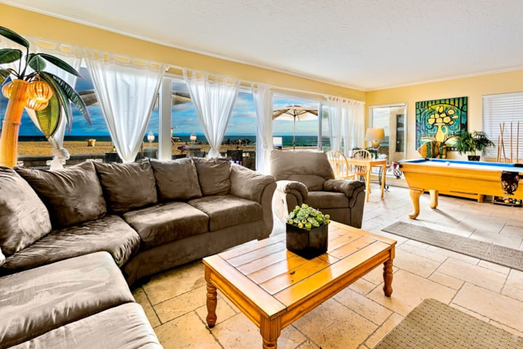 Living Room with sweeping ocean views and lots of comfortable seating.