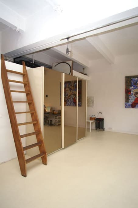 stairs leading to mezzanine and double bed. Large mirror cupboard.