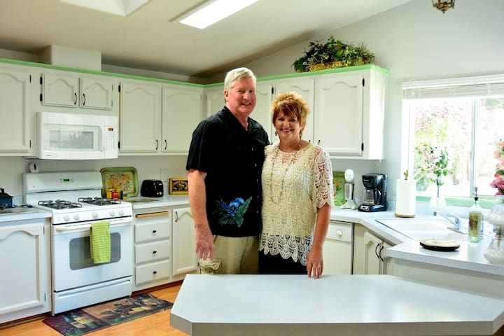 Matt and Barb show off the modern kitchen with vintage touches. Image courtesy of D. Dyson Photography.