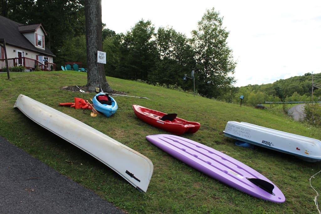2 kayaks, 1 standup paddle board, canoe & paddle board, also 2 bikes