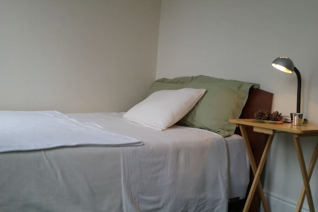 Full size bed with a firm mattress.