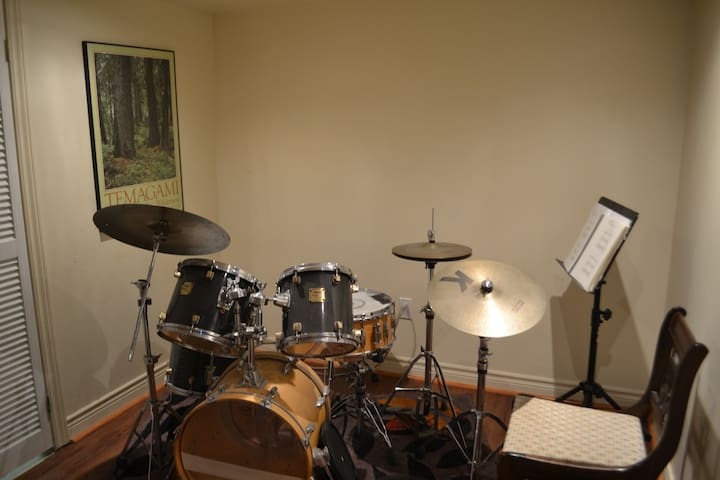 Drums just outside the studio and played only when you are out.