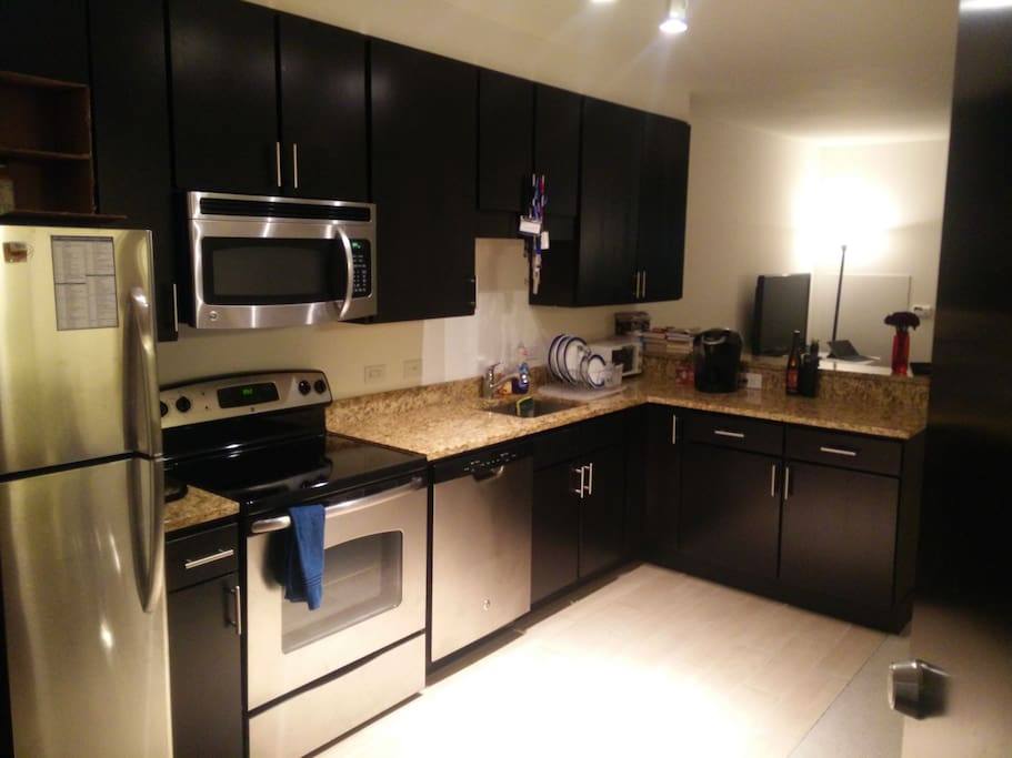 Fully equipped kitchen with new GE stainless steel appliances