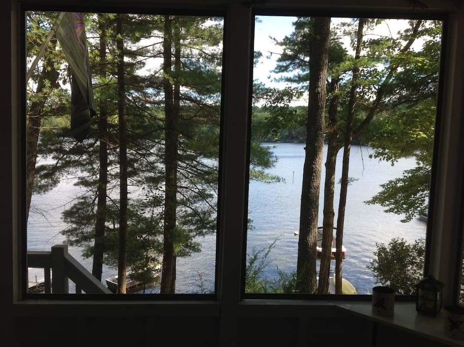 The screen porch overlooks Crescent Lake.