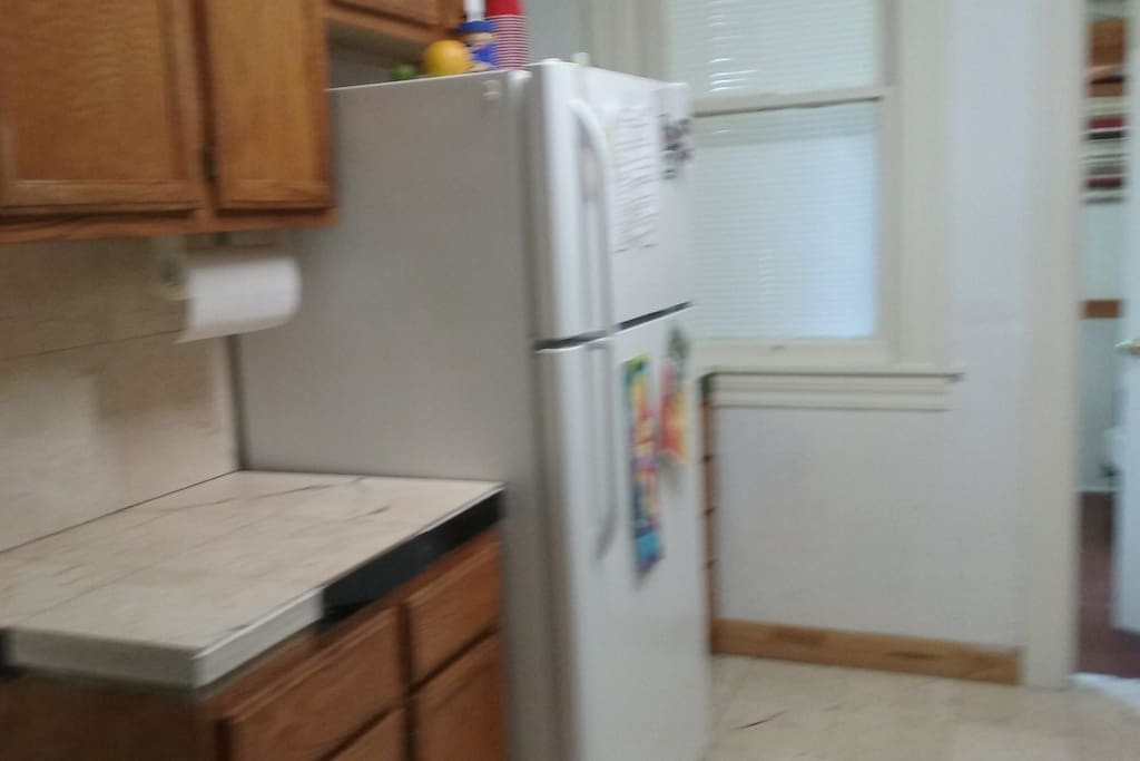 kitchen with gas stove and microwave and toast r oven