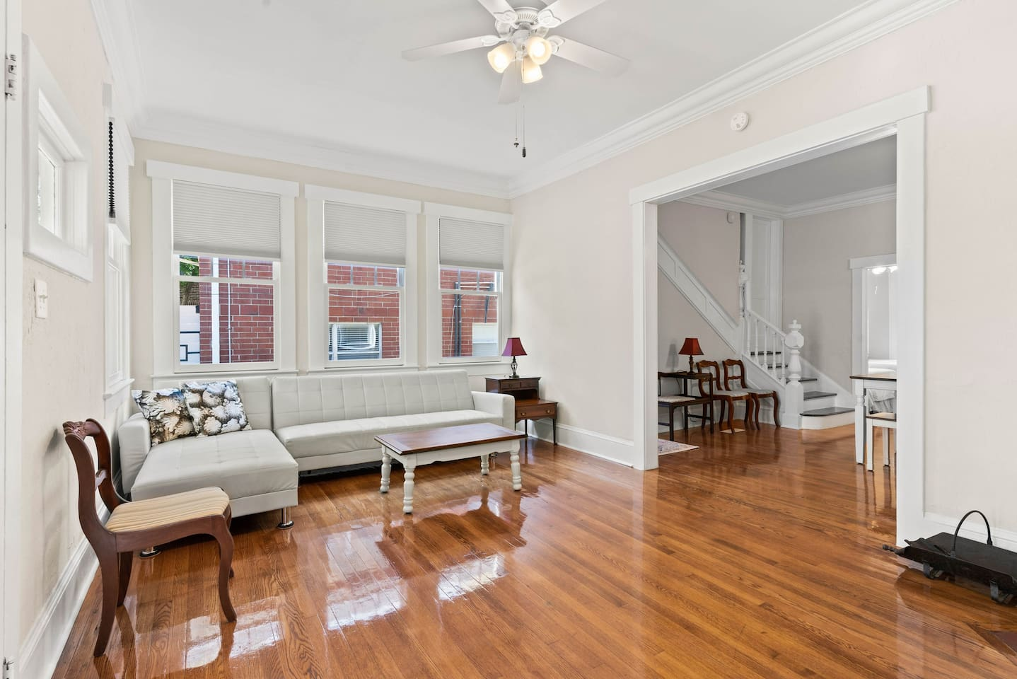Refinished hardwood floors, high ceilings, crown molding, original craftsman details, and antique furniture throughout