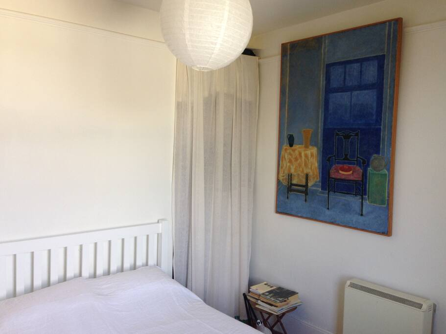 Double bed with paintings in the room
