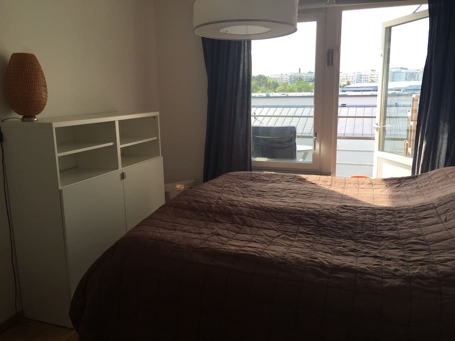 Bedroom 1, with balcony. The bed is 180 cm.