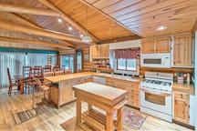 The spacious cabin-style kitchen provides plenty of seating and ample to room to whip up a tasty meal.