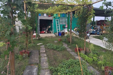一日農莊主人與綠油油稻田為鄰置身果園之中體驗農人悠閒生活!附烹煮設備。 - 麻豆區 - Capanna