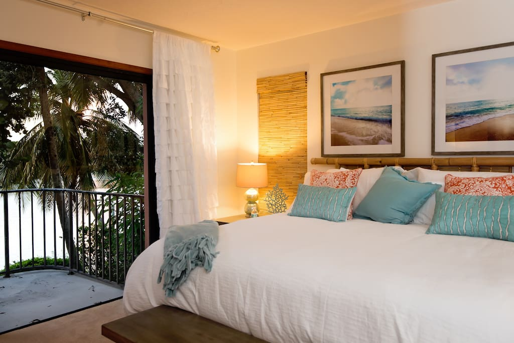 Master bedroom with balcony overlooking the waterway!