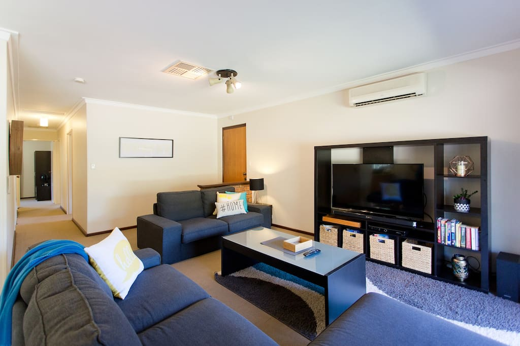 Lounge area with TV and sound bar
