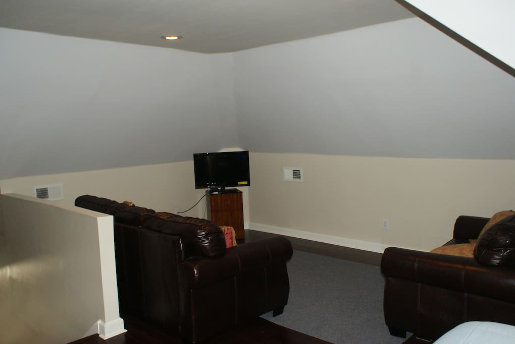 Private Upstairs Bonus room: available for entertaining or accommodates a nightly stay in queen real bed +/-queen size air mattress. Private sofa, love seat and cable TV if you would like to enjoy movie night in the privacy of your room. Bonus area does not have door.