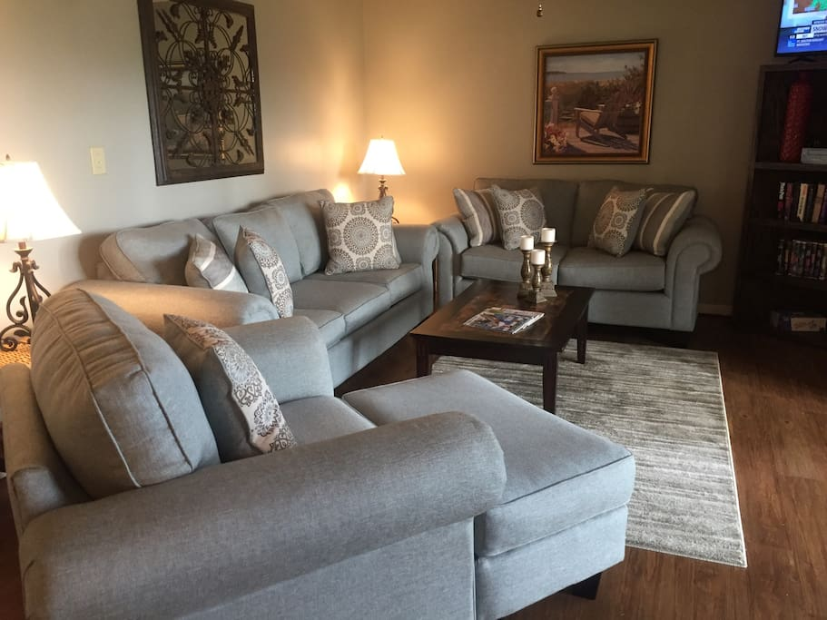 Spacious living room with new furniture.. queen size sleeper sofa!