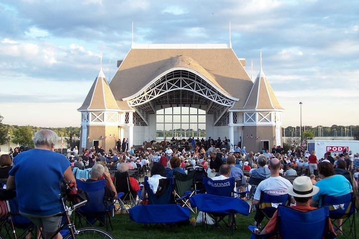 Borrow our bikes and check out the Chain of Lakes and summer concert series at the Lake Harriet Band Shell.