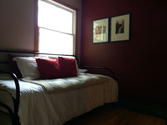 Small bedroom on upper level with a trundle bed (two twins).