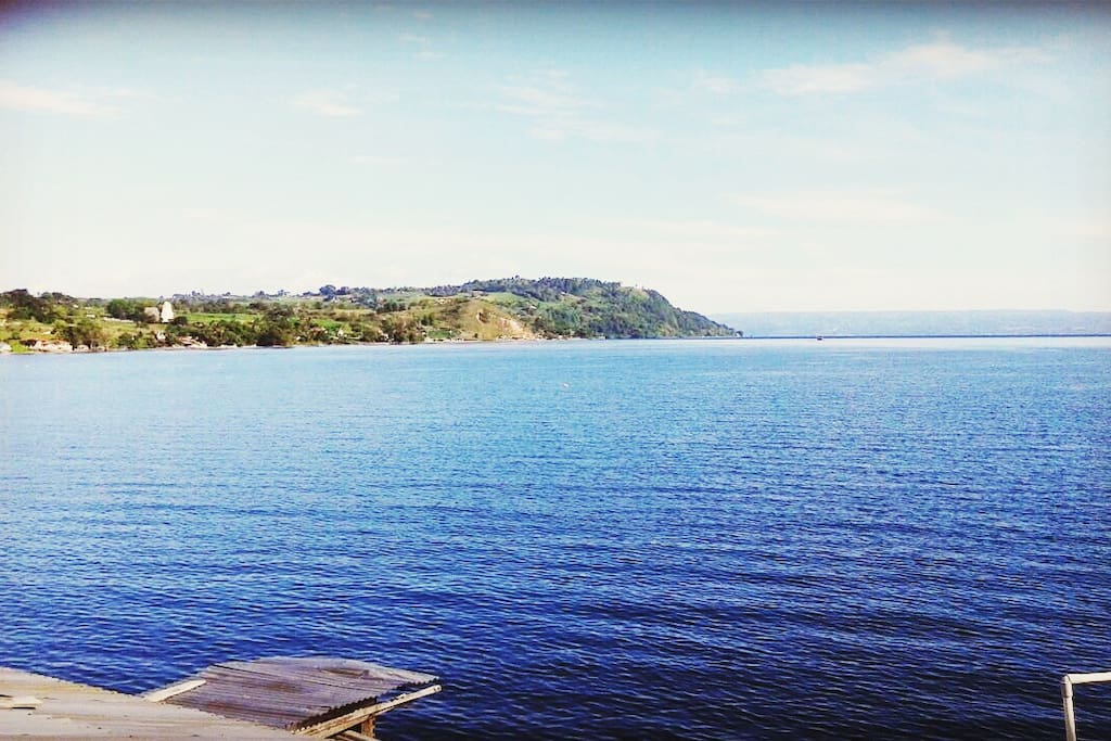 Lake Toba. Right on the backside of the house. Small garden and barbeque area is available