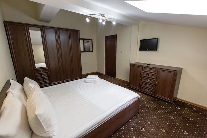 Suite with bedroom & living room in hotel