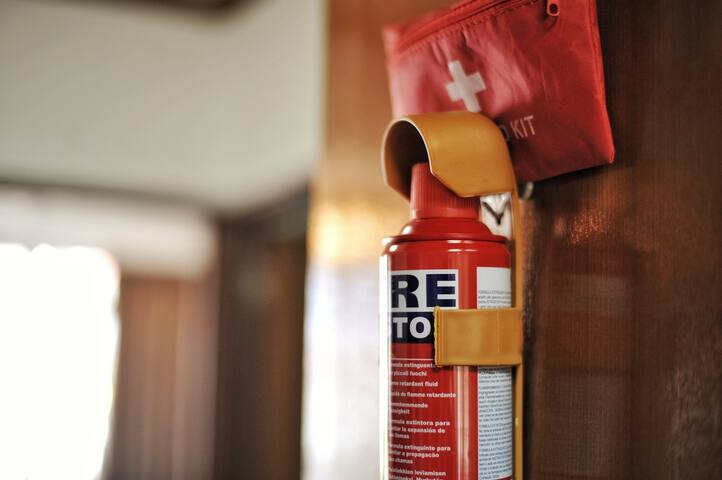 Mini fire extinguisher at kitchen area and small first aid kit.