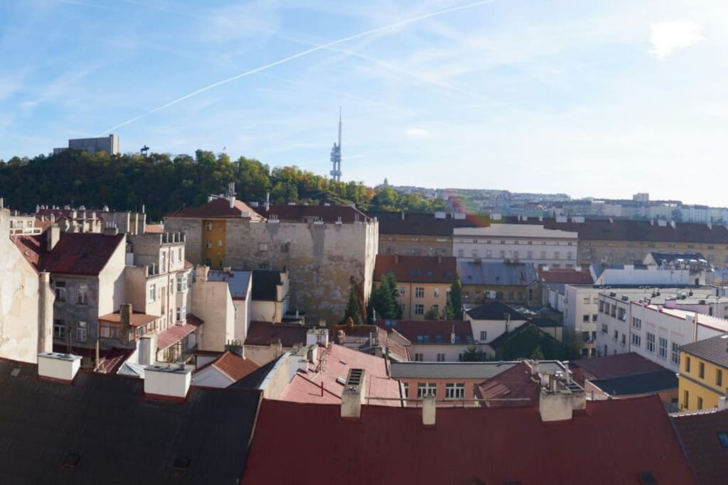Vitkov Hill with largest horse statue in Europe on the top of it and Zizkov TV tower