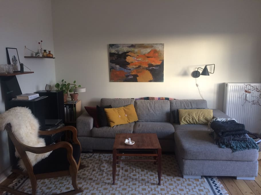 Light living room with big couch.