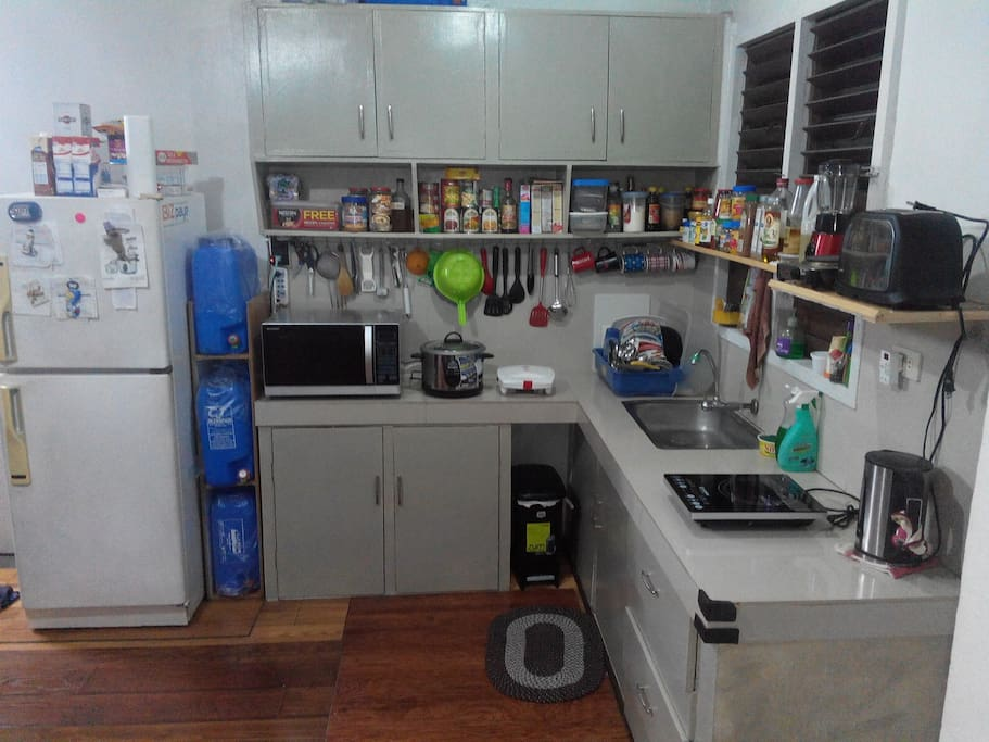 Common Kitchen with NEW modern appliances including Microwave/Oven, Induction Cooker, Rice Cooker, Sandwich Maker, Toaster, Blender and more...