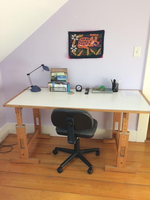 Large work surface with desk accessories and local information.