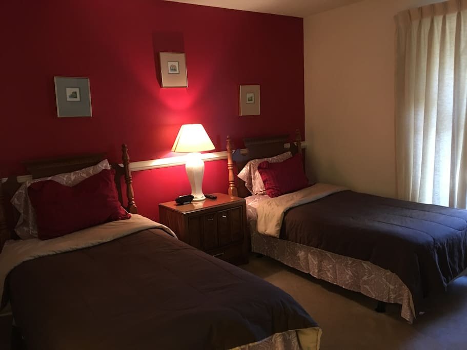 One of the bedrooms with twin beds and bathroom.