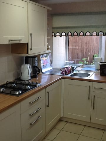 Newly decorated kitchen, with back door leading out in to garden. Light and airy room with access to oven, fridge etc