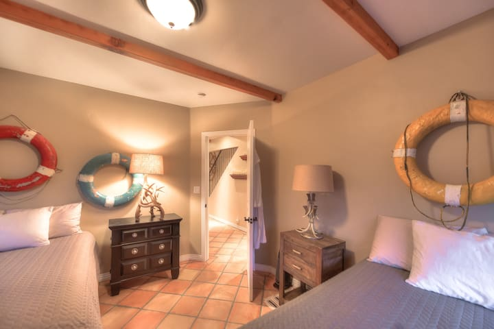 Lower level bedroom with 2 double beds