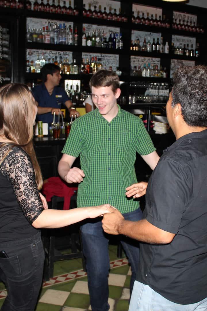 Guests learning to dance Rueda de Casino