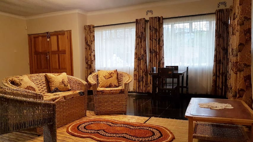 The African themed lounge with small  dining table