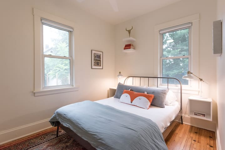 1st floor bedroom with queen Leesa bed. All beds have bedside lamps and nightstands are equipped for mobile charging.