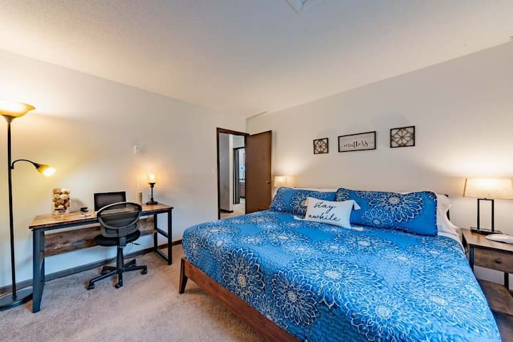 """King bed with 6 pillows, phone chargers ports built into the bedside lights, a dedicated office area, 32"""" Roku TV, blackout blinds and walk in closet with full length mirror."""