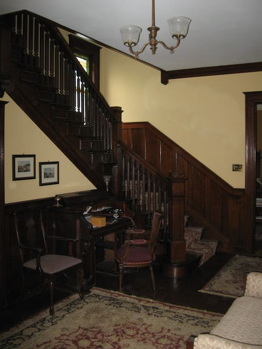 The front hallway and stairway that leads to the second floor bedrooms.