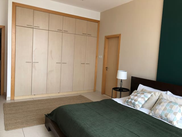 Large integrated closet. you can also see the private bathroom entrance on the right.