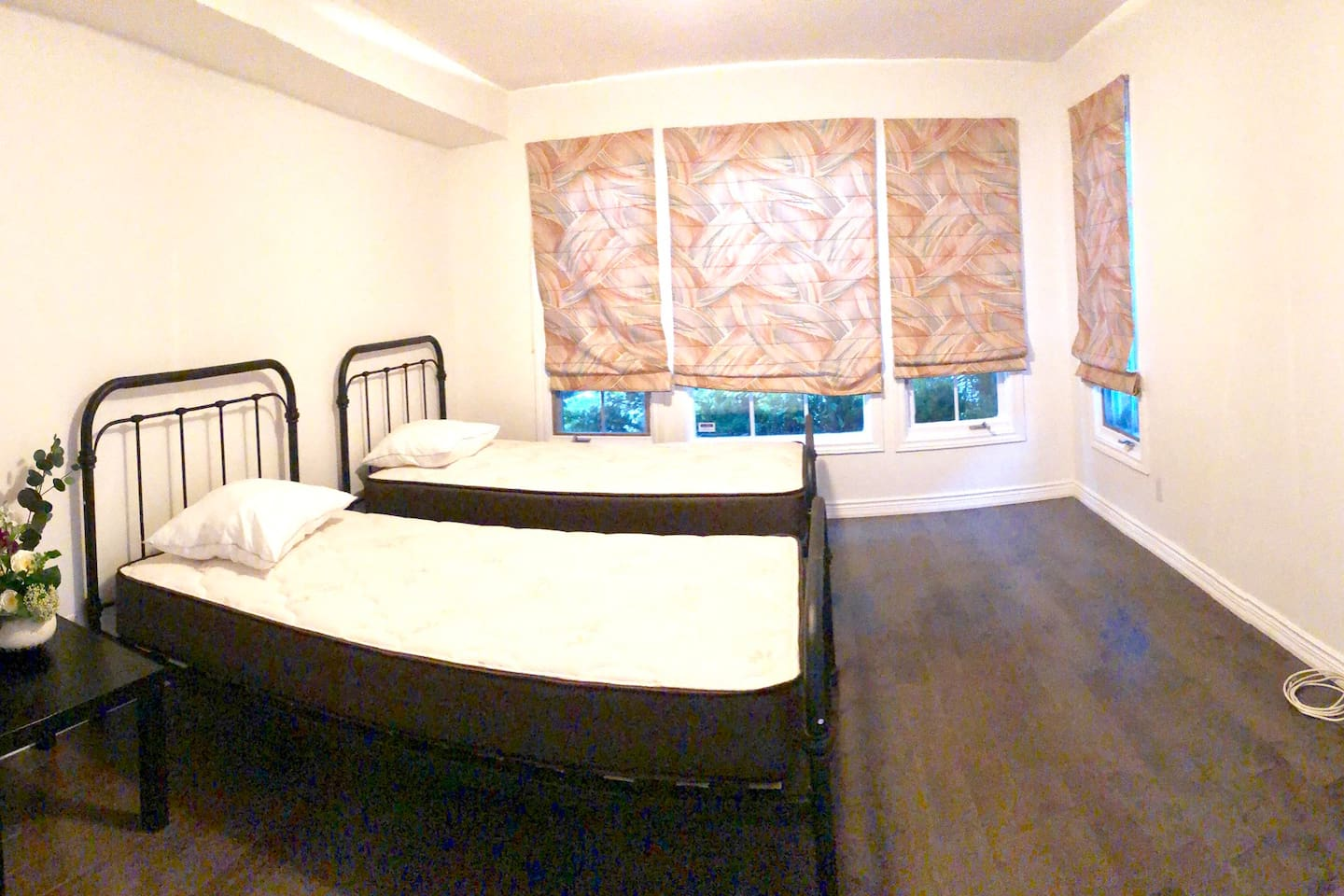 Room with two twin bed and private bathroom down the hall.