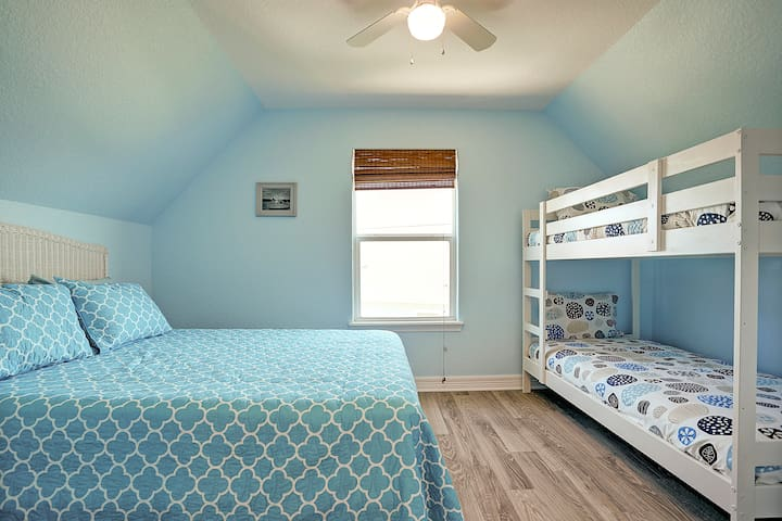 First upstairs bedroom. Queen bed and two bunks