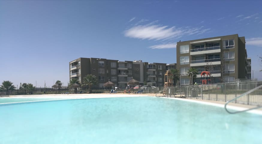 Apto en Condominio Laguna Navegable Piscinas arena - Santigo - Apartment