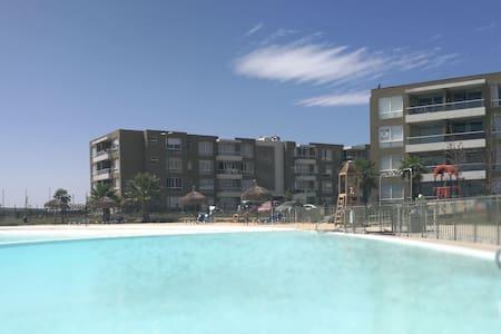 Apto en Condominio Laguna Navegable Piscinas arena - Santigo - Apartamento