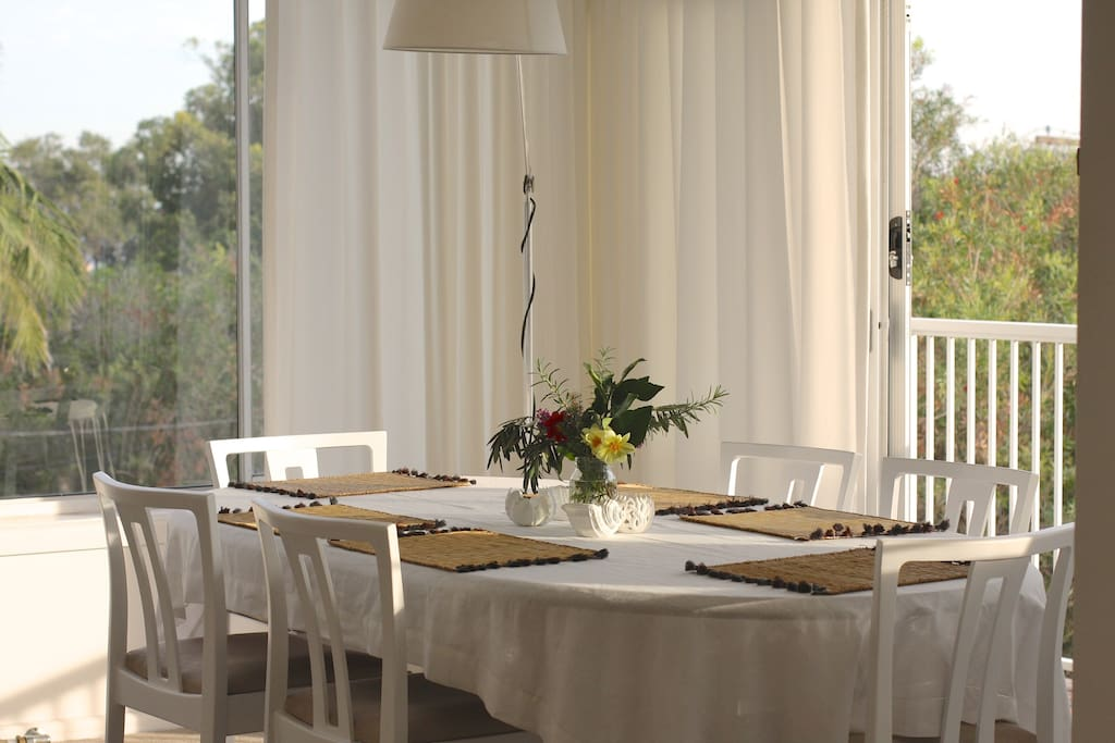 Sunfilled Dining area with table for 6 guests