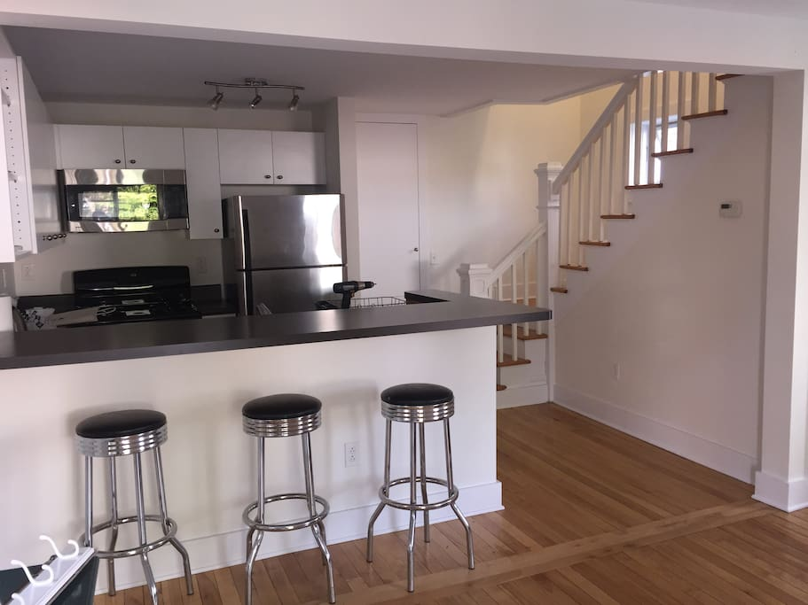 Breakfast bar showing upstairs access